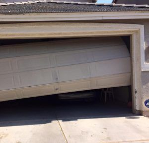 damaged-garage-door-panel-phoenix